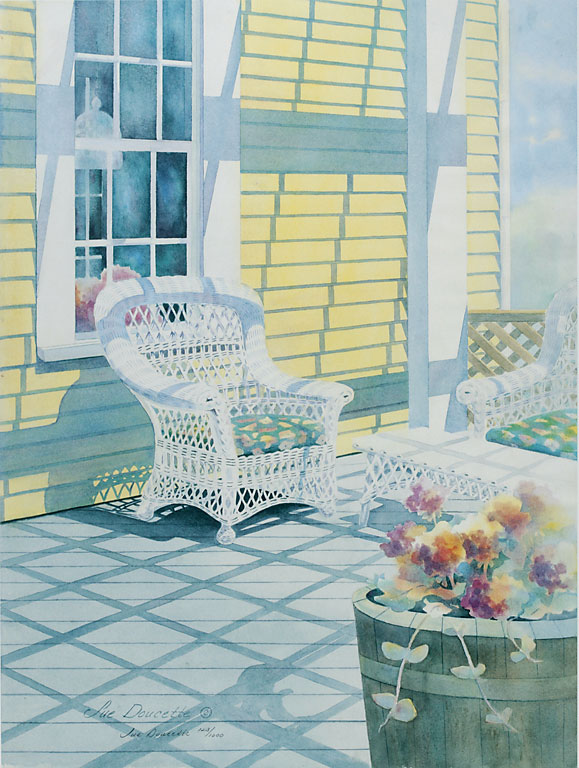 White wicker chair on porch with shadows